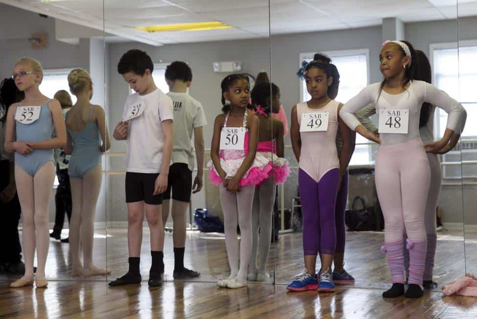 Boys and girls wait to perform during auditions for The School of American Ballet (SAB) in the Bronx borough of New York